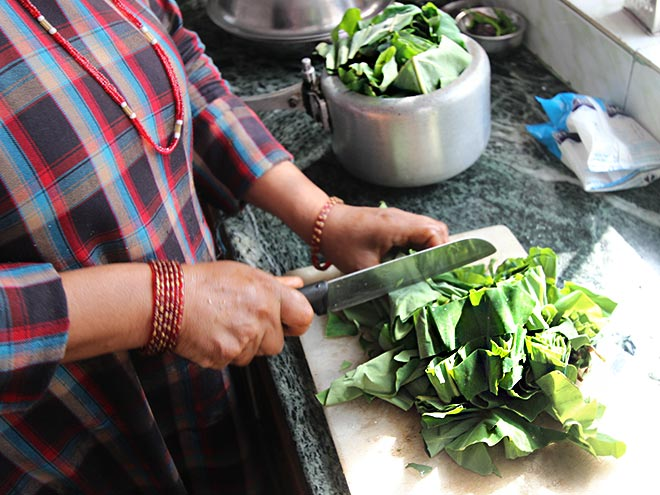 Preparing Yam leaves for Gaba
