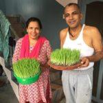 Guru and Sara with wheatgrass for juicing
